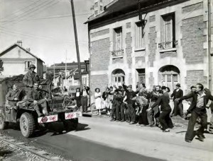 WC-52 parading through a liberated French village
